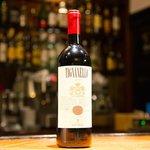 Eine Flasche exquisiter Wein. In der La Cantinetta gibt es eine atemberaubende Weinauswahl!