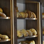 The new bread shelves stocked with artisan bread
