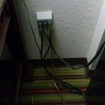 closeup of electrical plug overcrowding - a hazard