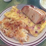 Ham and cheese omelette, hash browns, and toast