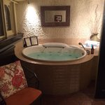 Whirlpool in sunroom in suite in Carriage House
