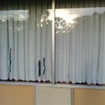 plastic curtains torn and stuck to window
