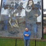 Guide Adrian, with mural in background