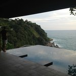 Our private infinity pool adjacent to an outdoor lounge area.