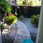 Entrance to shower in private back yard of Fale. Outdoors.