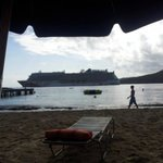 Beach with giant cruise ship passing