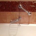 broken soap dish in bathroom