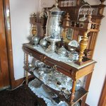 Beautiful antique hutches and silverware