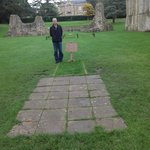 At King Arthur's tomb in Glastonbury Abbey in England
