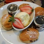 Scones as big as a miniature jam pot and as flat as a biscuit.