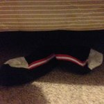 Someone else's socks at the foot of my bed