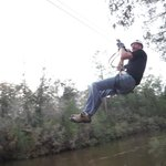 Zip lining over the river.