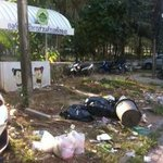 trash along road in front of hotels