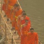 Watch the monks cross the bridge from breakfast area