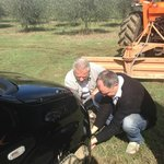 Alberto assiting the farmer to haul our car out!