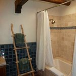 jacuzzi tub and skylight