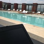 working at the rooftop pool