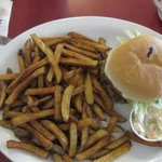 Burger and fries with coleslaw.