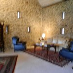 Beautiful old barn stone walls in the sitting room.