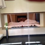 View of fireplace from the bathtub