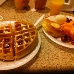 Yummy fresh fruit and hot waffles