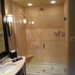 Awesome batherom with a heated floor, walk-in glass rain shower and great toiletries