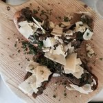 crostini al campo croce: a toasted baguette with mushroom top with cheese appetizer