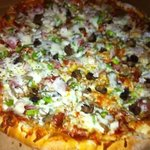 indy's staple the''mess'' pizza baked on stone deck ovens