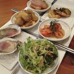 Appertizer to share starring fresh oysters, prawns, sashimi, octopus salad and cod