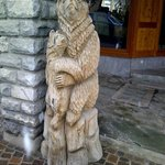 wooden carved bear sculpture in shopping area