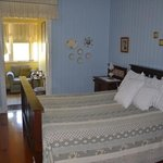 queen bedroom with sun room and ensuite.