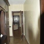 Wardrobes behind bed, door to lounge