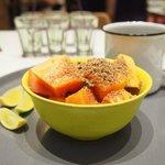 My raw choice of breakfast - fresh papaya, flaxseeds and sweet lime