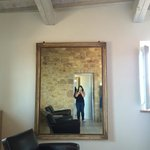 Large mirror in the room made the big room seem even bigger