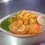 Hand battered cod on a fish shaped plate !!