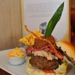 Our famous 'pig burger'!! 8 oz beef burger, pulled pork, smokey bacon, topped with homemade appl
