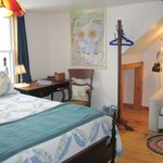 Queen bed room with lovely view of the back pastures and the stars at night.   Couch folds out t