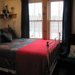 Room # 4 has a sunny view of the pastures, is air conditioned. Lovely quilted antique iron and b
