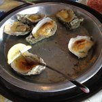 Baked oysters on the half shell