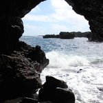 Don't miss the cave on the south side of beach.