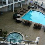 Plenty of seating areas around the pool and hot tub