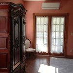 Dulcinea - Armoire and French Doors to Private Patio