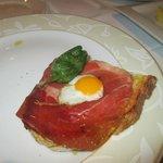 Sirloin on souirdough bread, red pepper sauce, quails egg and padron pepper