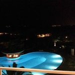 view of pool at night from Room 450