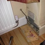 Dampness on wall, dirty sockets, skirting lying on floor