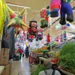 Produce market, with pinatas