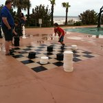 Lifesize checkers and chess by the pool
