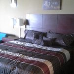 wall pictures and king bed