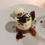 Chocolate mousse dessert with icecream marmalade and chocolate sauce.