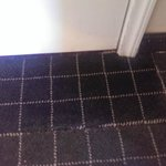 Poorly patched carpet in doorway